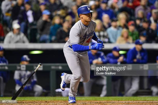 Trayce Thompson of the Los Angeles Dodgers singles in a pinch hit appearance in the third inning of a game against the Colorado Rockies at Coors...