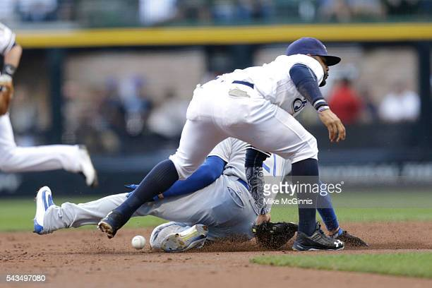 Trayce Thompson of the Los Angeles Dodgers slides to second base interrupting the throw to Jonathan Villar of the Milwaukee Brewers during the second...