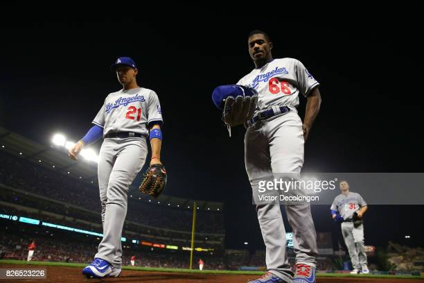 Trayce Thompson Yasiel Puig and Joc Pederson of the Los Angeles Dodgers make their way to the dugout after the fifth inning during the MLB game...