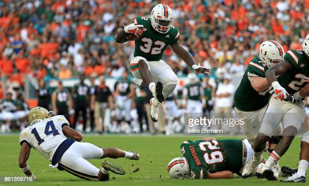 Trayone Gray of the Miami Hurricanes rushes during a game against the Georgia Tech Yellow Jackets at Sun Life Stadium on October 14 2017 in Miami...