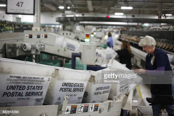 Trays of periodicals are pictured before being sorted by postal workers at the United States Postal Service sorting center in Louisville Kentucky US...