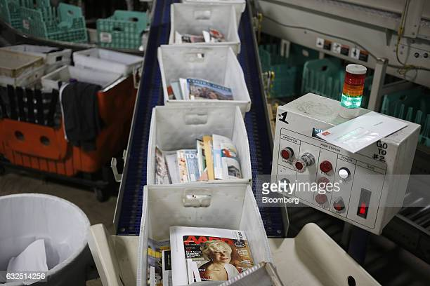 Trays of periodicals are seen before being sorted by postal workers at the United States Postal Service sorting center in Louisville Kentucky US on...