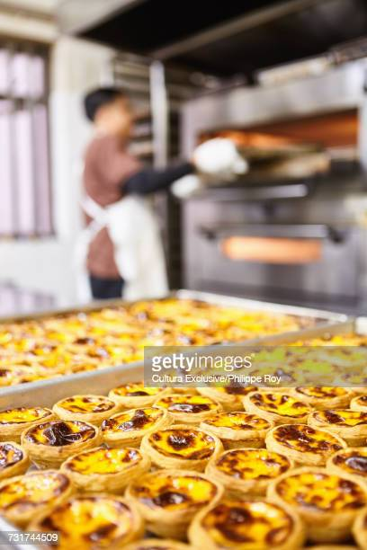 Trays of traditional egg tarts on food stall, Macau