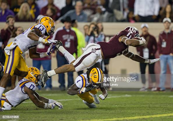 Trayveon Williams of the Texas AM Aggies flipsover the goal line for a touchdown as he his hit by Donte Jackson of the LSU Tigers in the second half...