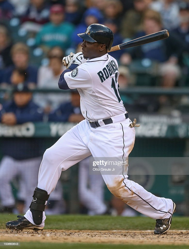 Trayvon Robinson #12 of the Seattle Mariners bats against the Los Angeles Angels of Anaheim at Safeco Field on October 3, 2012 in Seattle, Washington.