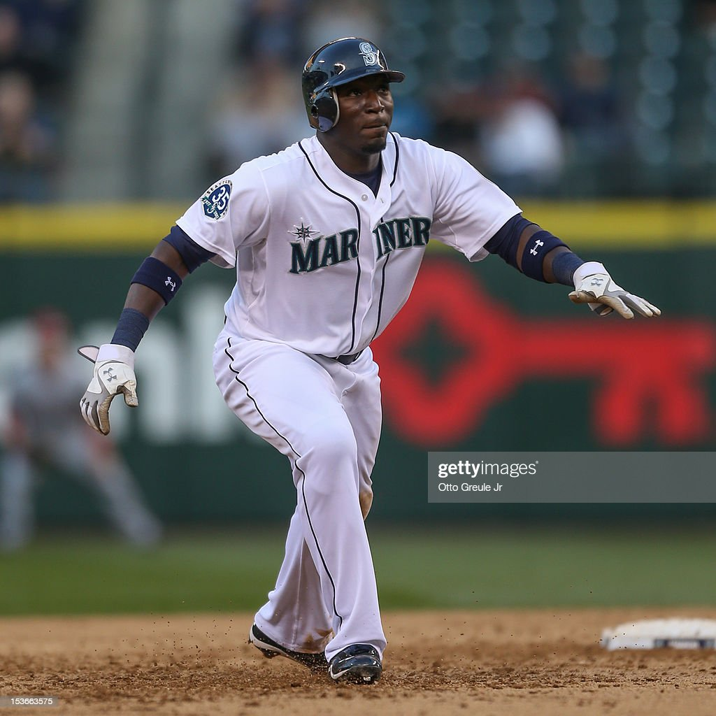 Trayvon Robinson #12 of the Seattle Mariners leads off of second base against the Los Angeles Angels of Anaheim at Safeco Field on October 3, 2012 in Seattle, Washington.