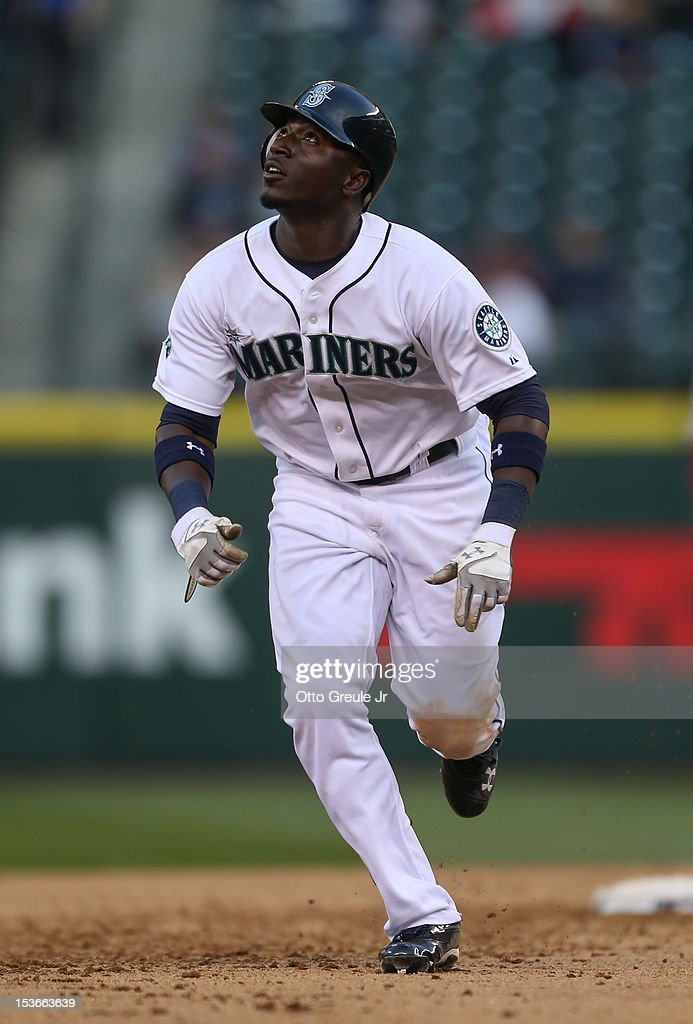 Trayvon Robinson #12 of the Seattle Mariners rounds the bases against the Los Angeles Angels of Anaheim at Safeco Field on October 3, 2012 in Seattle, Washington.