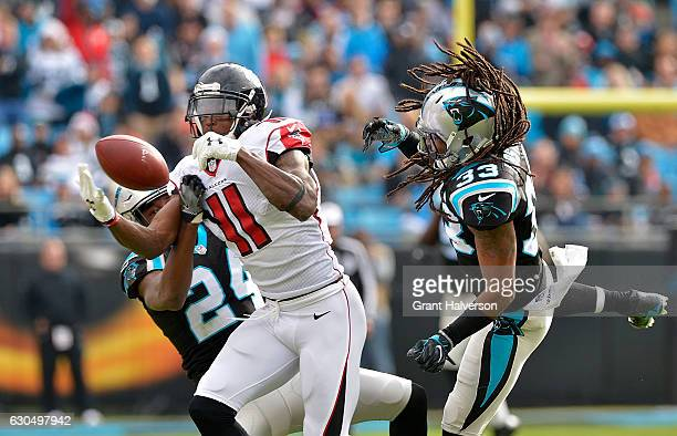 Tre Boston and teammate James Bradberry of the Carolina Panthers defend a pass to Julio Jones of the Atlanta Falcons in the 1st quarter during the...