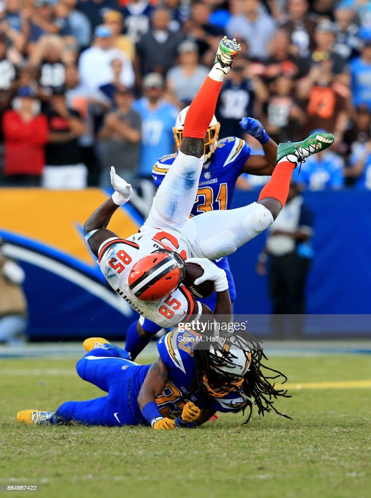 Tre Boston #33 of the Los Angeles Chargers upends David Njoku #85 of the Cleveland Browns on a short pass play during the second half of a game at StubHub Center on December 3, 2017 in Carson, California.