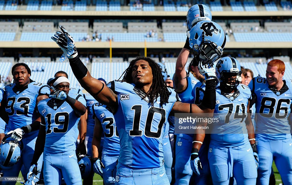 <a gi-track='captionPersonalityLinkClicked' href=/galleries/search?phrase=Tre+Boston&family=editorial&specificpeople=7173024 ng-click='$event.stopPropagation()'>Tre Boston</a> #10 of the North Carolina Tar Heels leads the singing of the alma mater after a win over the Middle Tennessee State Blue Raiders at Kenan Stadium on September 7, 2013 in Chapel Hill, North Carolina. North Carolina won 40-20.