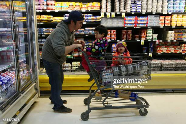 Tre Chavez left shops with his adopted children Khloe Anderson center and Maryann Anderson right in the Alaska Commercial store in Bethel AK on May...