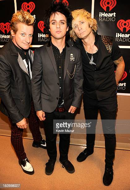 Tre Cool Billie Joe Armstrong and Mike Durnt of Green Day backstage during the 2012 iHeartRadio Music Festival at MGM Grand Garden Arena on September...