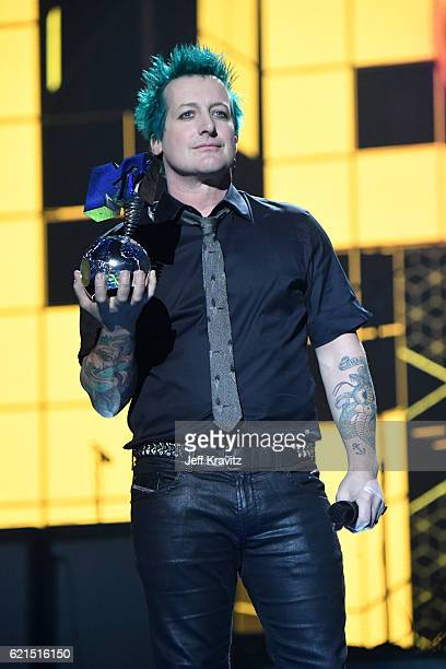 ROTTERDAM NETHERLANDS NOVEMBER Tre Cool of Green Day accepts Global Icon award on stage at the MTV Europe Music Awards 2016 on November 6 2016 in...