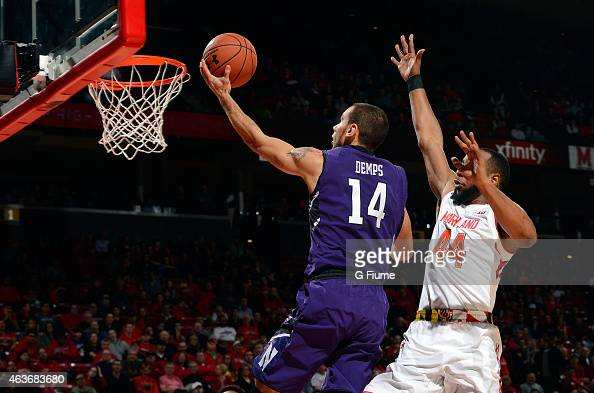 Tre Demps of the Northwestern Wildcats drives to the hoop against the Maryland Terrapins at the Xfinity Center on January 25 2015 in College Park...