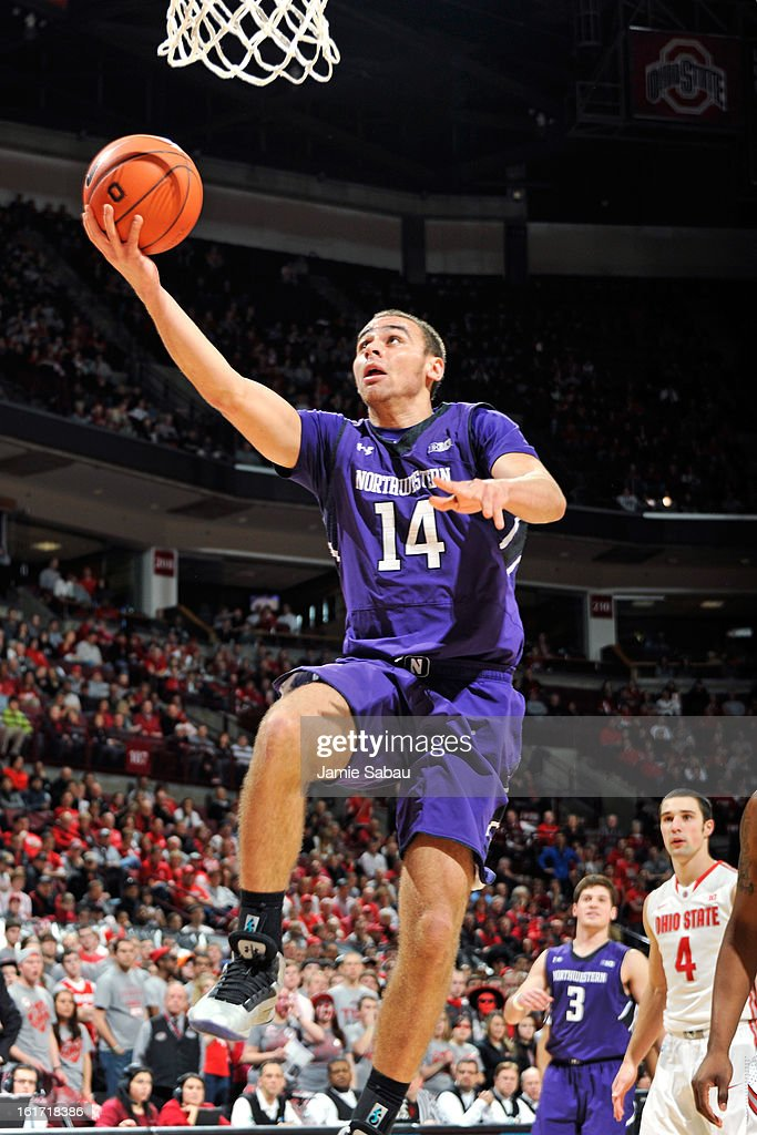 Tre Demps #14 of the Northwestern Wildcats lays in two points in the first half against the Ohio State Buckeyes on February 14, 2013 at Value City Arena in Columbus, Ohio. Ohio State defeated Northwestern 69-59.