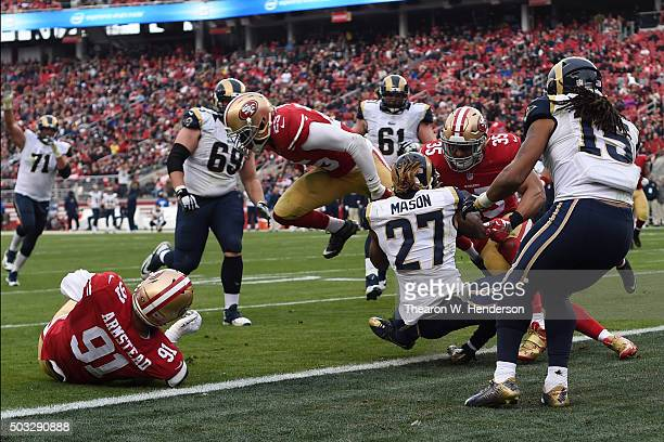 Tre Mason of the St Louis Rams rushes for a fouryard touchdown against the San Francisco 49ers during their NFL game at Levi's Stadium on January 3...