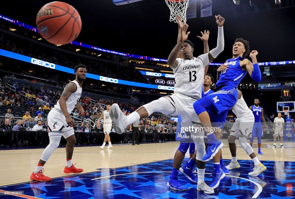 Tre Scott #13 of the Cincinnati Bearcats and David Nickelberry #15 of the Memphis Tigers fight for a loose ball during a semifinal game of the 2018 AAC Basketball Championship at Amway Center on March 10, 2018 in Orlando, Florida.