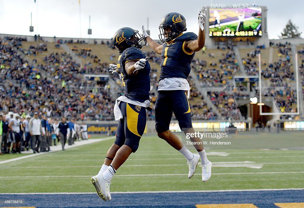 Tre Watson and Bryce Treggs of the California Golden Bears celebrates after Watson scored a touchdown against the Brigham Young Cougars during the...