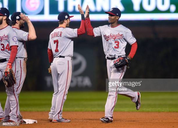 Trea Turner and Michael A Taylor of the Washington Nationals celebrate after defeatingthe Chicago Cubs 50 in game four of the National League...