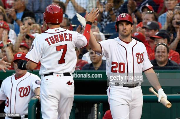 Trea Turner of the Washington Nationals celebrates with Daniel Murphy after scoring in the first inning against the Arizona Diamondbacks at Nationals...