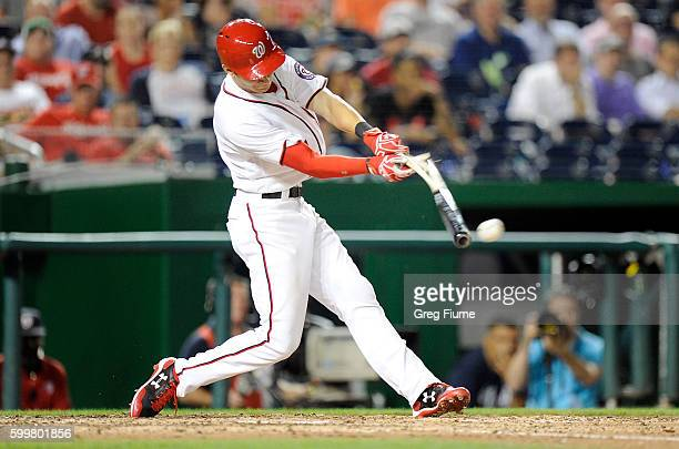 Trea Turner of the Washington Nationals shatters his bat on a tworun single in the eighth inning against the Atlanta Braves at Nationals Park on...