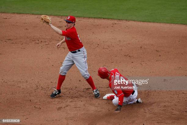 Trea Turner of the Washington Nationals steals second base ahead of the tag by Brock Holt of the Boston Red Sox in the fifth inning during a spring...