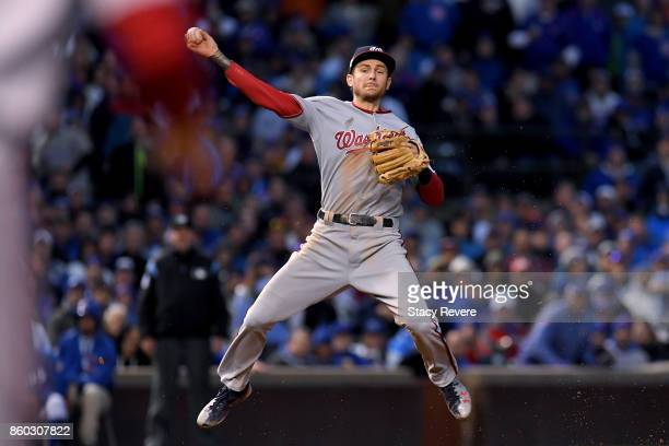 Trea Turner of the Washington Nationals throws to first base in the sixth inning during game four of the National League Division Series against the...