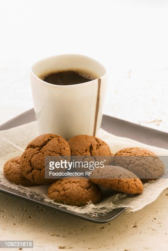 Treacle biscuits and coffee on tray