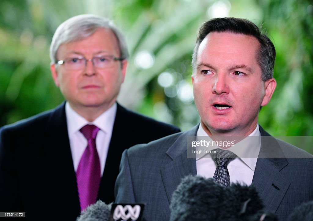 Treasurer Chris Bowen and Prime Minister <a gi-track='captionPersonalityLinkClicked' href=/galleries/search?phrase=Kevin+Rudd&family=editorial&specificpeople=707751 ng-click='$event.stopPropagation()'>Kevin Rudd</a> speak at a media conference that outlines federal budget cuts on July 16, 2013 in Townsville, Australia. The government today announced a 3.9 billion savings package including public service staffing cuts and changes to the fringe benefits tax on cars to pay for the decision to abolish the carbon tax one year early in favour of an emissions trading scheme in 2014.
