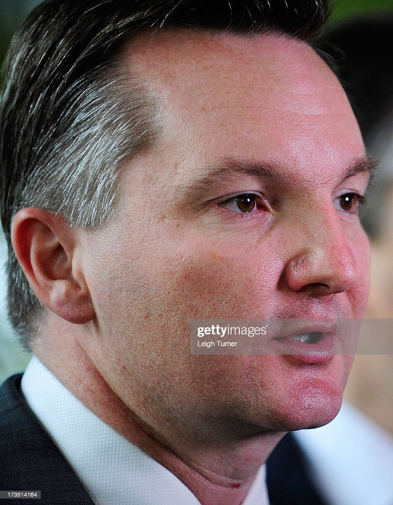 Treasurer Chris Bowen speaks at a media conference that outlines federal budget cuts on July 16, 2013 in Townsville, Australia. The government today announced a 3.9 billion savings package including public service staffing cuts and changes to the fringe benefits tax on cars to pay for the decision to abolish the carbon tax one year early in favour of an emissions trading scheme in 2014.