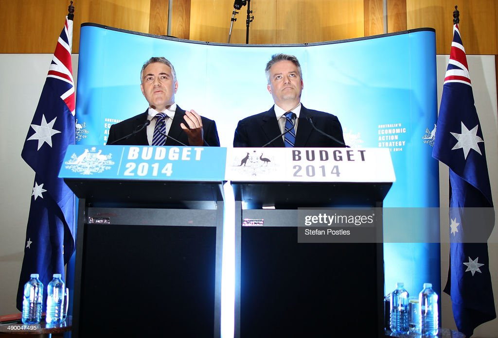 Treasurer <a gi-track='captionPersonalityLinkClicked' href=/galleries/search?phrase=Joe+Hockey&family=editorial&specificpeople=2961513 ng-click='$event.stopPropagation()'>Joe Hockey</a> and Finance Minister Mathias Cormann speak to the media during a press conference within the budget lockup at Parliament House on May 13, 2014 in Canberra, Australia. Tony Abbott's Coalition government will deliver it's first federal budget tonight and is expected to reveal several welfare spending cuts and tax increases as well as increases in defence and infrastructure spending.