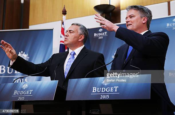 Treasurer Joe Hockey and Minister for Finance Mathias Cormann hold a press conference during the Budget lockup in Parliament House on May 12 2015 in...