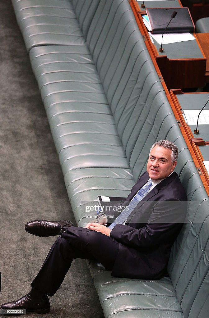 Treasurer <a gi-track='captionPersonalityLinkClicked' href=/galleries/search?phrase=Joe+Hockey&family=editorial&specificpeople=2961513 ng-click='$event.stopPropagation()'>Joe Hockey</a> before House of Representatives question time at Parliament House on May 14, 2014 in Canberra, Australia. Australian Treasurer <a gi-track='captionPersonalityLinkClicked' href=/galleries/search?phrase=Joe+Hockey&family=editorial&specificpeople=2961513 ng-click='$event.stopPropagation()'>Joe Hockey</a> last night delivered the federal budget announcing plans to reduce welfare, health and education program spending and increases taxes to bring the deficit down from $AUD 48.9 billion this year to $AUD 2.8 billion by 2017-2018.