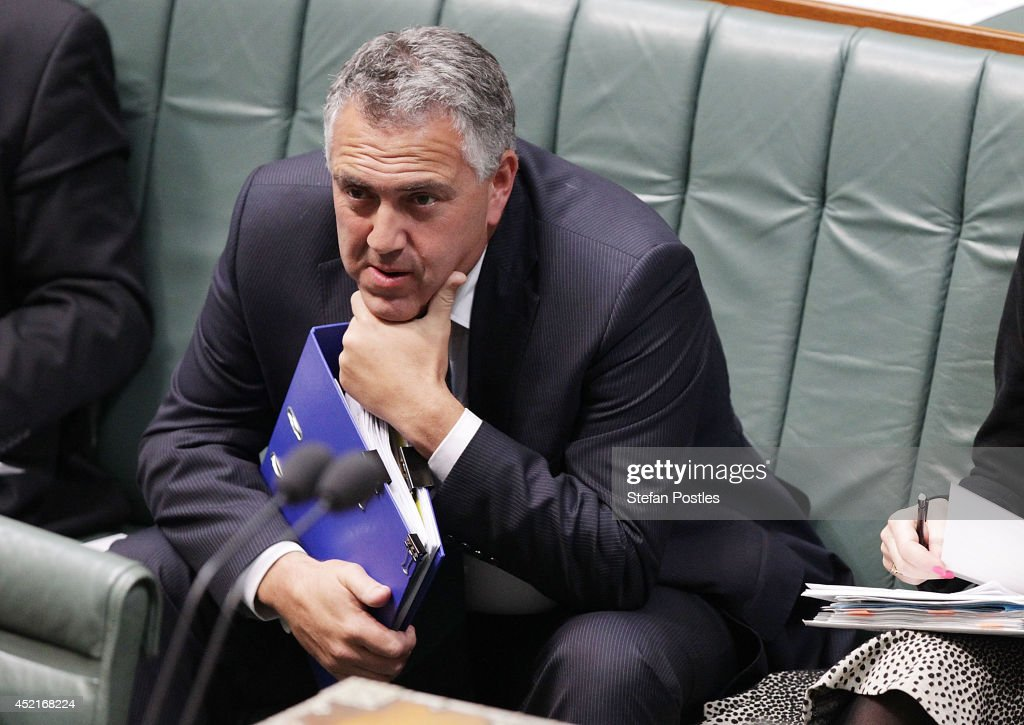 Treasurer <a gi-track='captionPersonalityLinkClicked' href=/galleries/search?phrase=Joe+Hockey&family=editorial&specificpeople=2961513 ng-click='$event.stopPropagation()'>Joe Hockey</a> during Question Time at Parliament House on July 15, 2014 in Canberra, Australia. A vote on the Government's Carbon Tax Repeal Legislation has been delayed as debate in the Senate continues.