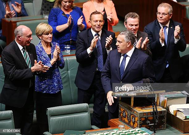Treasurer Joe Hockey is congratulated after delivering the budget in the House of Representatives in Parliament House on May 12 2015 in Canberra...