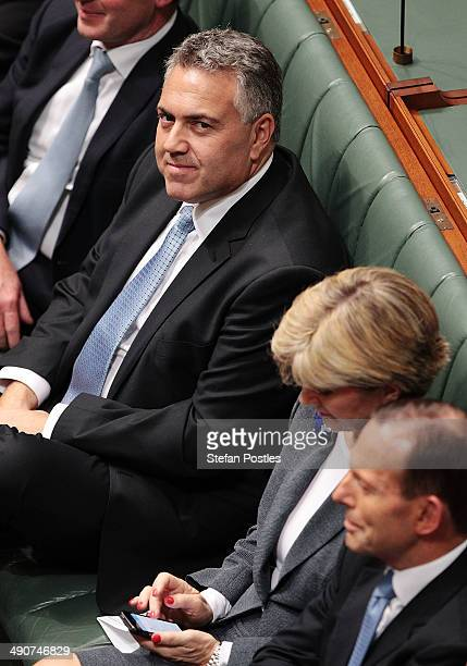 Treasurer Joe Hockey listens to opposition leader Bill Shorten deliver his budget reply speech on May 15 2014 in Canberra Australia The opposition...