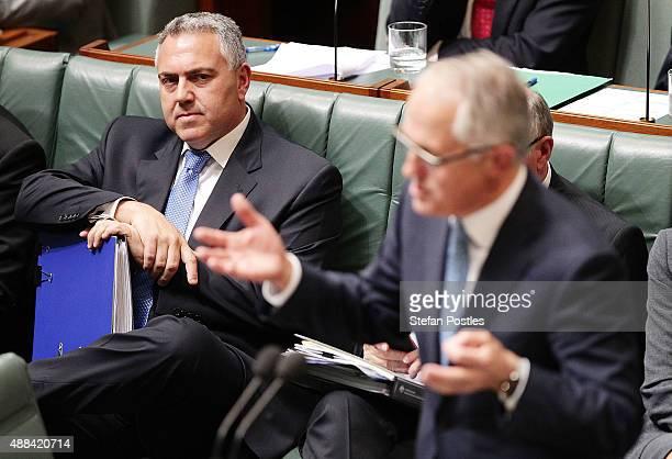 Treasurer Joe Hockey listens to Prime Minister Malcolm Turnbull speak during House of Representatives question time at Parliament House on September...