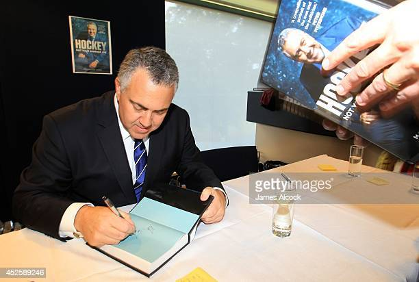 Treasurer Joe Hockey signs autographs at his biography launch at North Sydney Oval on July 24 2014 in Sydney Australia The biography authored by...