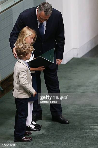 Treasurer Joe Hockey's daughter and son look over his budget after he delivered it in the House of Representatives in Parliament House on May 12 2015...