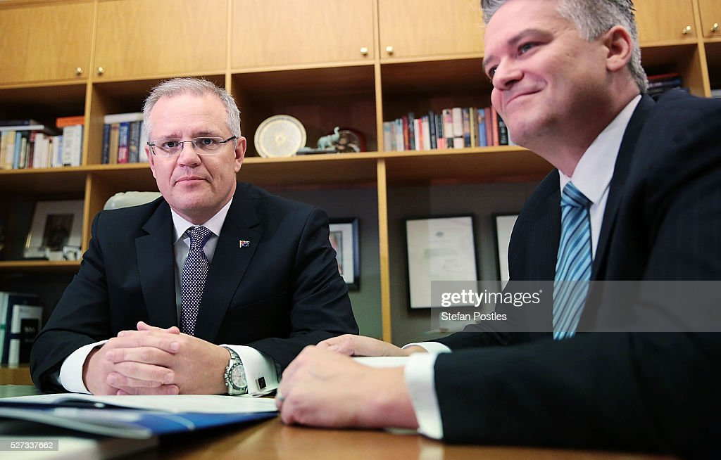 Treasurer Scott Morrison and Minister for Finance Mathias Cormann pose with the 2016 Federal Budget papers in the Treasurers office at Parliament House on May 3, 2016 in Canberra, Australia. The Coalition government will deliver the 2016 federal budget tonight, and is expected to announce changes to the tax system for individuals and business as well as changes to superannuation.