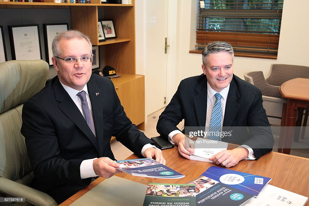 Treasurer Scott Morrison and Minister for Finance Mathias Cormann sit with the 2016 Federal Budget papers in the Treasurers office at Parliament House on May 3, 2016 in Canberra, Australia. The Coalition government will deliver the 2016 federal budget tonight, and is expected to announce changes to the tax system for individuals and business as well as changes to superannuation.