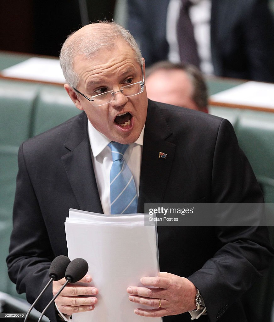 Treasurer Scott Morrison during House of Representatives question time at Parliament House on May 4, 2016 in Canberra, Australia. The Turnbull Goverment's first budget has delivered tax cuts for small and medium businesses, income tax cuts people earning over $80,000 a year,new measures to help young Australians into jobs and cutbacks to superannuation concessions for the wealthy.
