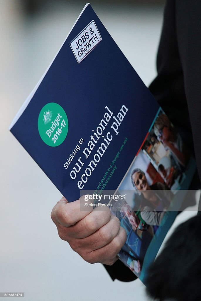 Treasurer Scott Morrison holds 2016 Budget booklet titled 'Sticking to our national economic plan' during a door stop outside Parliament House on May 3, 2016 in Canberra, Australia. The Coalition government will deliver the 2016 federal budget tonight, and is expected to announce changes to the tax system for individuals and business as well as changes to superannuation.