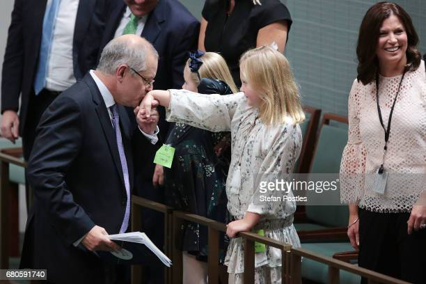 Treasurer Scott Morrison kisses his daughters hand after delivering the budget in the House of Representatives on May 9 2017 in Canberra Australia...