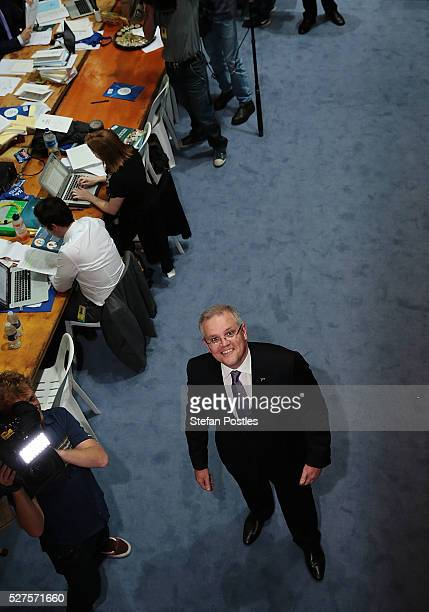 Treasurer Scott Morrison looks up at photographers in the budget lockup at Parliament House on May 3 2016 in Canberra Australia The Coalition...