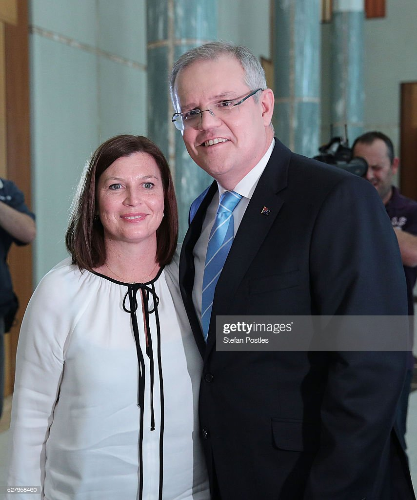 Treasurer Scott Morrison poses with his wife Jenny Morrison after delivering his post Budget National Press Club address in the Great Hall at Parliament House on May 4, 2016 in Canberra, Australia. The Turnbull Goverment's first budget has delivered tax cuts for small and medium businesses, income tax cuts people earning over $80,000 a year, new measures to help young Australians into jobs, and cutbacks to superannuation concessions for the wealthy.
