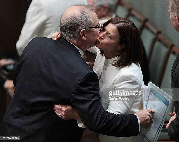 Treasurer Scott Morrison receives a hug and kiss from his wife Jennifer Morrison after delivering his budget in the House of Representatives at...