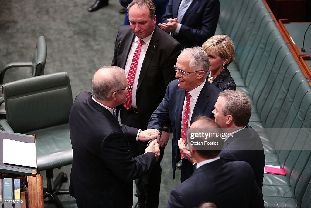 Treasurer Scott Morrison shakes hands with Prime Minister <a gi-track='captionPersonalityLinkClicked' href=/galleries/search?phrase=Malcolm+Turnbull&family=editorial&specificpeople=2125595 ng-click='$event.stopPropagation()'>Malcolm Turnbull</a> after delivering his budget in the House of Representatives at Parliament House on May 3, 2016 in Canberra, Australia. The Coalition government will deliver the 2016 federal budget tonight, and is expected to announce changes to the tax system for individuals and business as well as changes to superannuation.