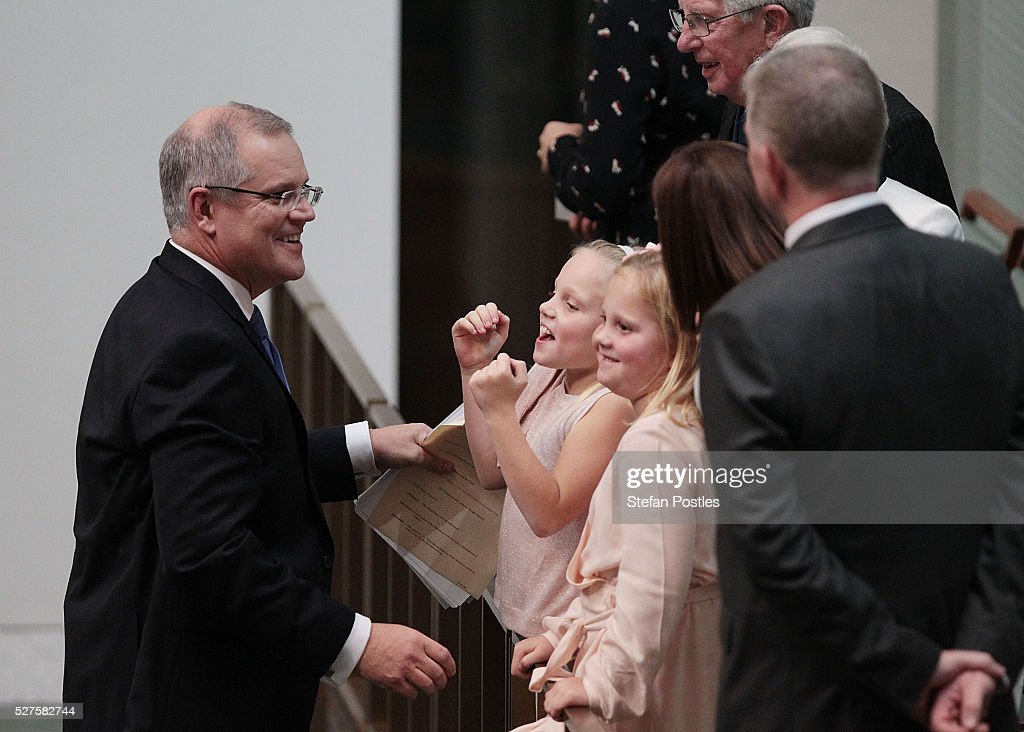 Treasurer Scott Morrison visits with his family after delivering his budget in the House of Representatives at Parliament House on May 3, 2016 in Canberra, Australia. The Coalition government will deliver the 2016 federal budget tonight, and is expected to announce changes to the tax system for individuals and business as well as changes to superannuation.