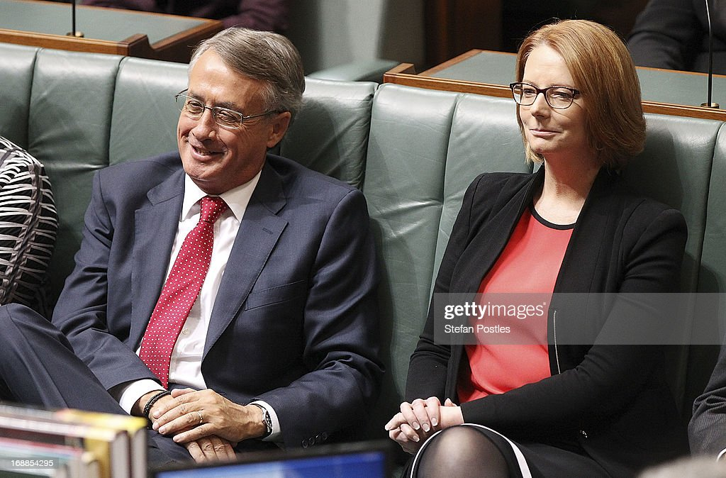 Treasurer <a gi-track='captionPersonalityLinkClicked' href=/galleries/search?phrase=Wayne+Swan&family=editorial&specificpeople=4582809 ng-click='$event.stopPropagation()'>Wayne Swan</a> and Prime Minister <a gi-track='captionPersonalityLinkClicked' href=/galleries/search?phrase=Julia+Gillard&family=editorial&specificpeople=787281 ng-click='$event.stopPropagation()'>Julia Gillard</a> listen to Opposition leader, Tony Abbott delivering his budget reply in the House of Representatives at Parliament House on May 16, 2013 in Canberra, Australia. Abbott is expected to address how a Coalition government will pay for tax cuts if elected on September 14. The government unveiled the 2013/2014 federal budget on Tuesday, revealing an 19.4 billion deficit with plans to reach surplus by 2016/2017 should the Labor party be re-elected this September.